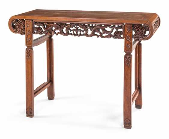 End table with in a breakthrough carved dragon decoration