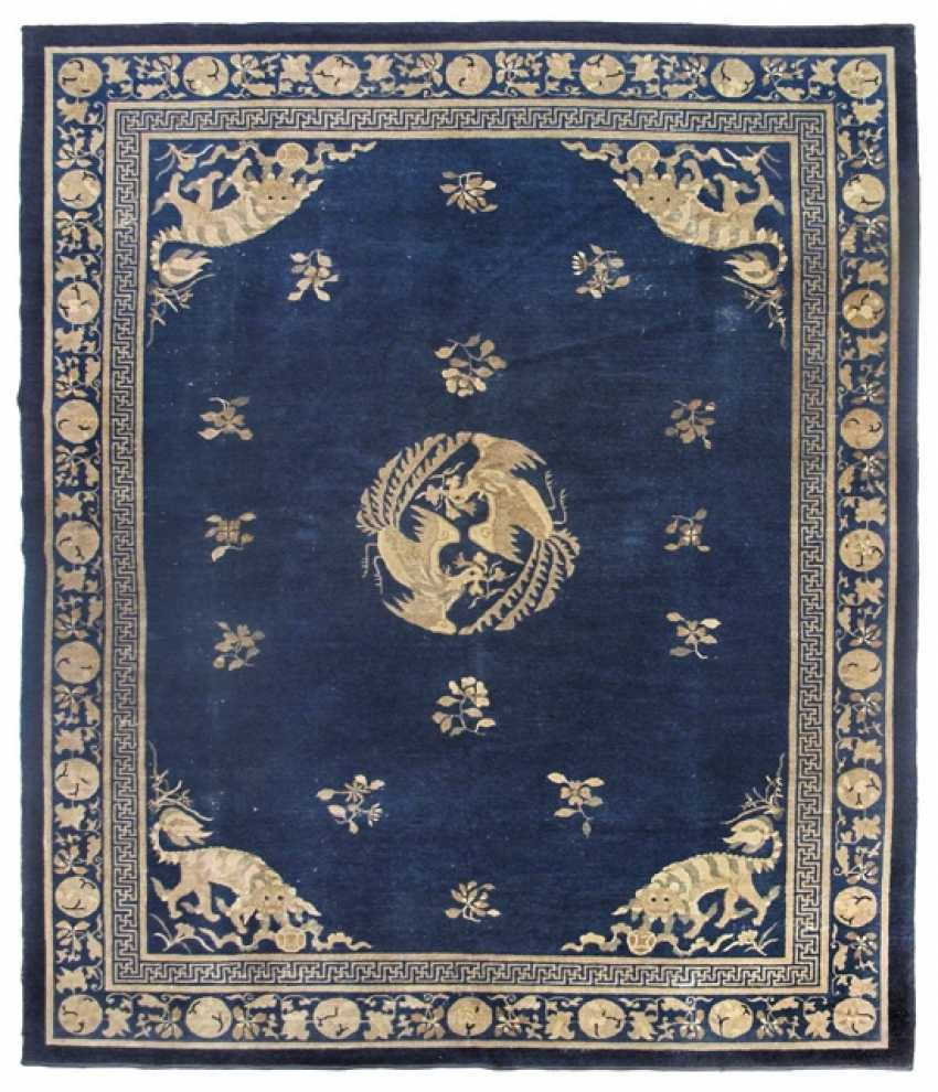Wool carpet with a Buddhist lion and two Central Phoenixes on a blue Fond - photo 1