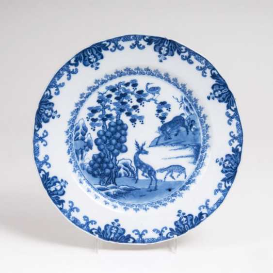 Blue-and-white plate with deer - photo 1