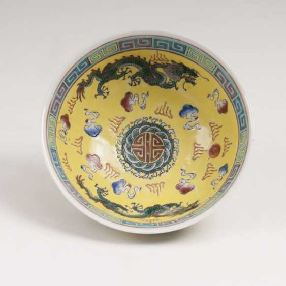Small bowl with dragon decoration on a yellow fond - photo 2