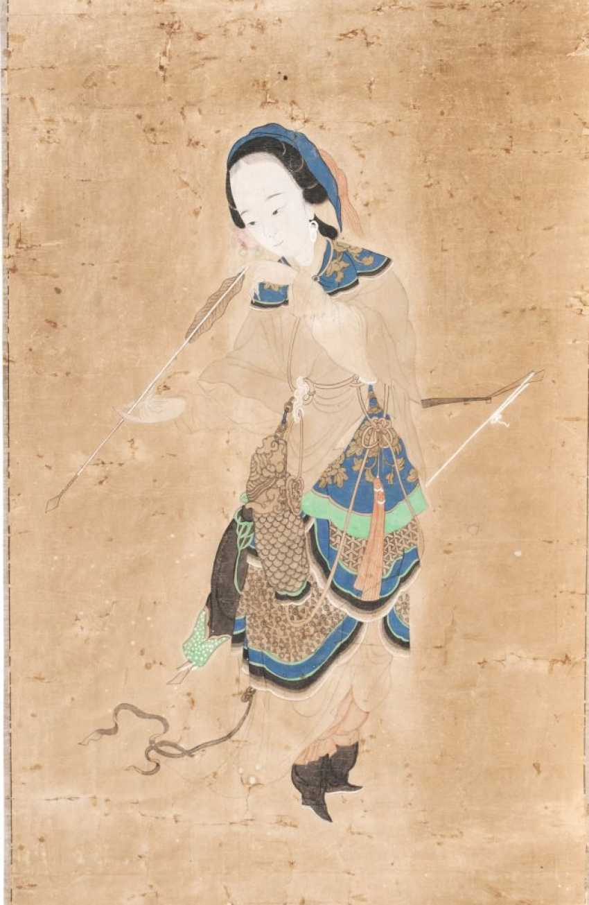 Young woman with bow and arrow - photo 1
