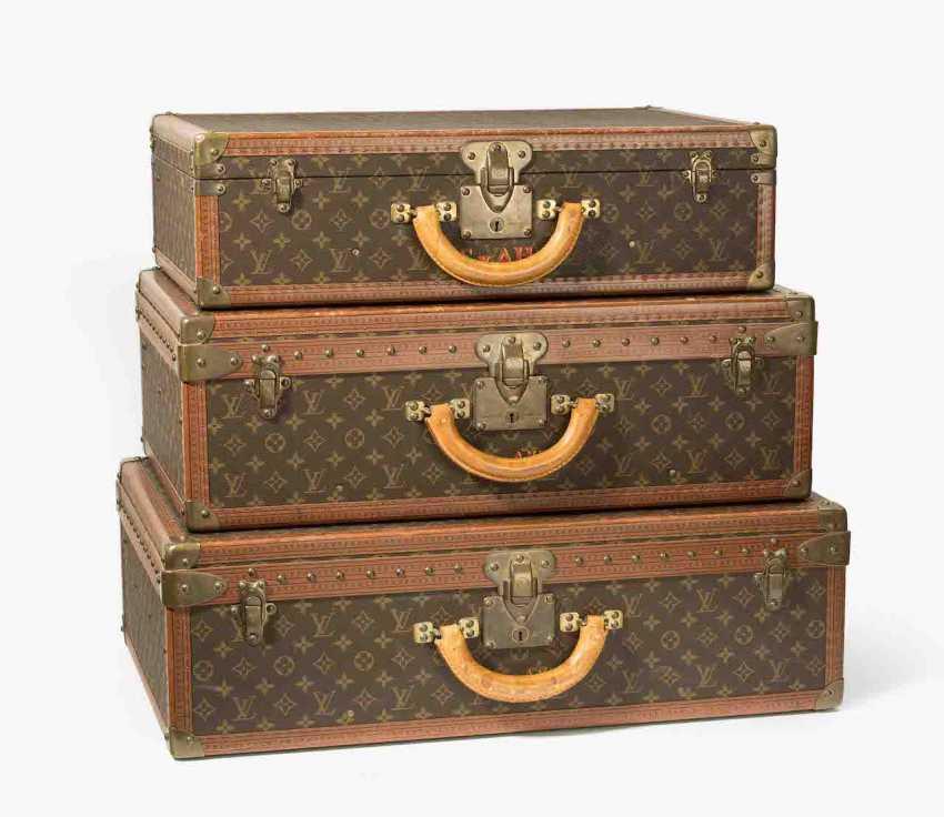 Louis Vuitton, three travel suitcases - photo 1