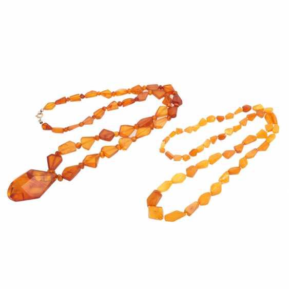 Set of 2 amber beads, - photo 1