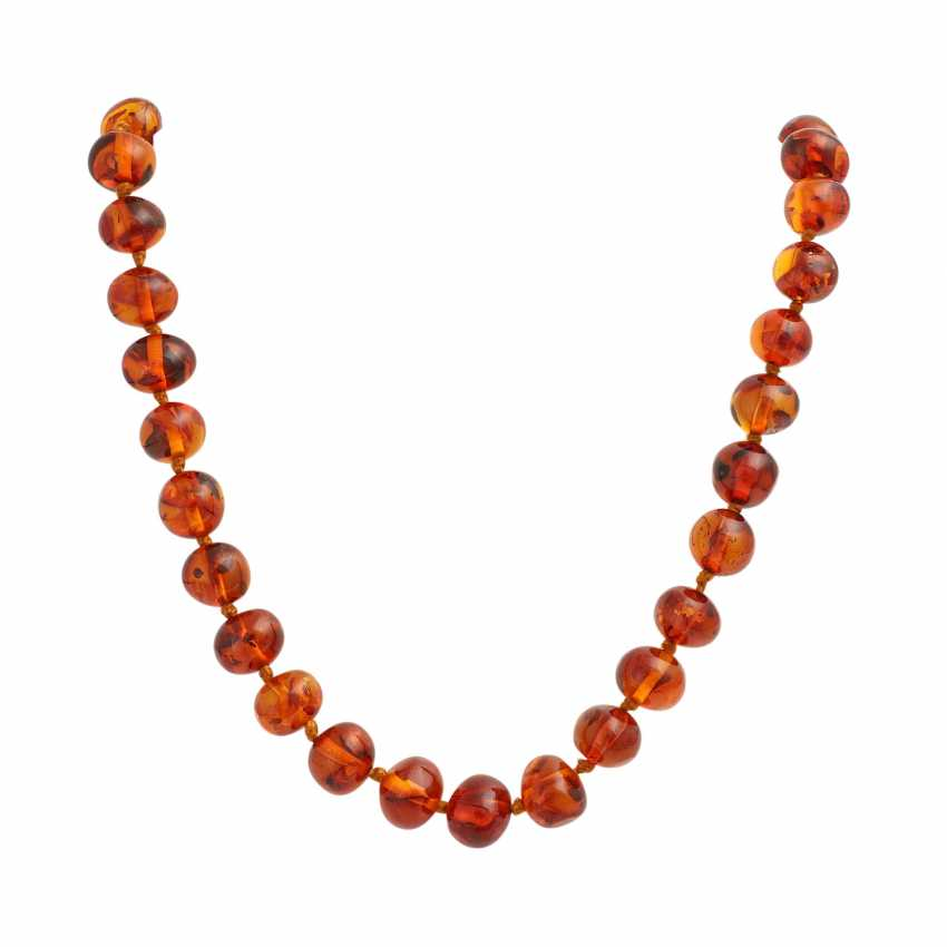 Long amber necklace in a slight curve, approx. 10-13,5 mm, - photo 1