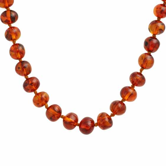 Long amber necklace in a slight curve, approx. 10-13,5 mm, - photo 2