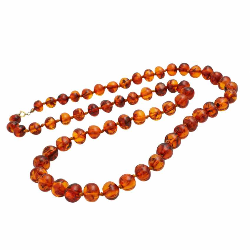 Long amber necklace in a slight curve, approx. 10-13,5 mm, - photo 3