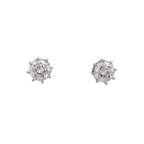 Pair of brilliant stud earrings approx. 1 ct - photo 1
