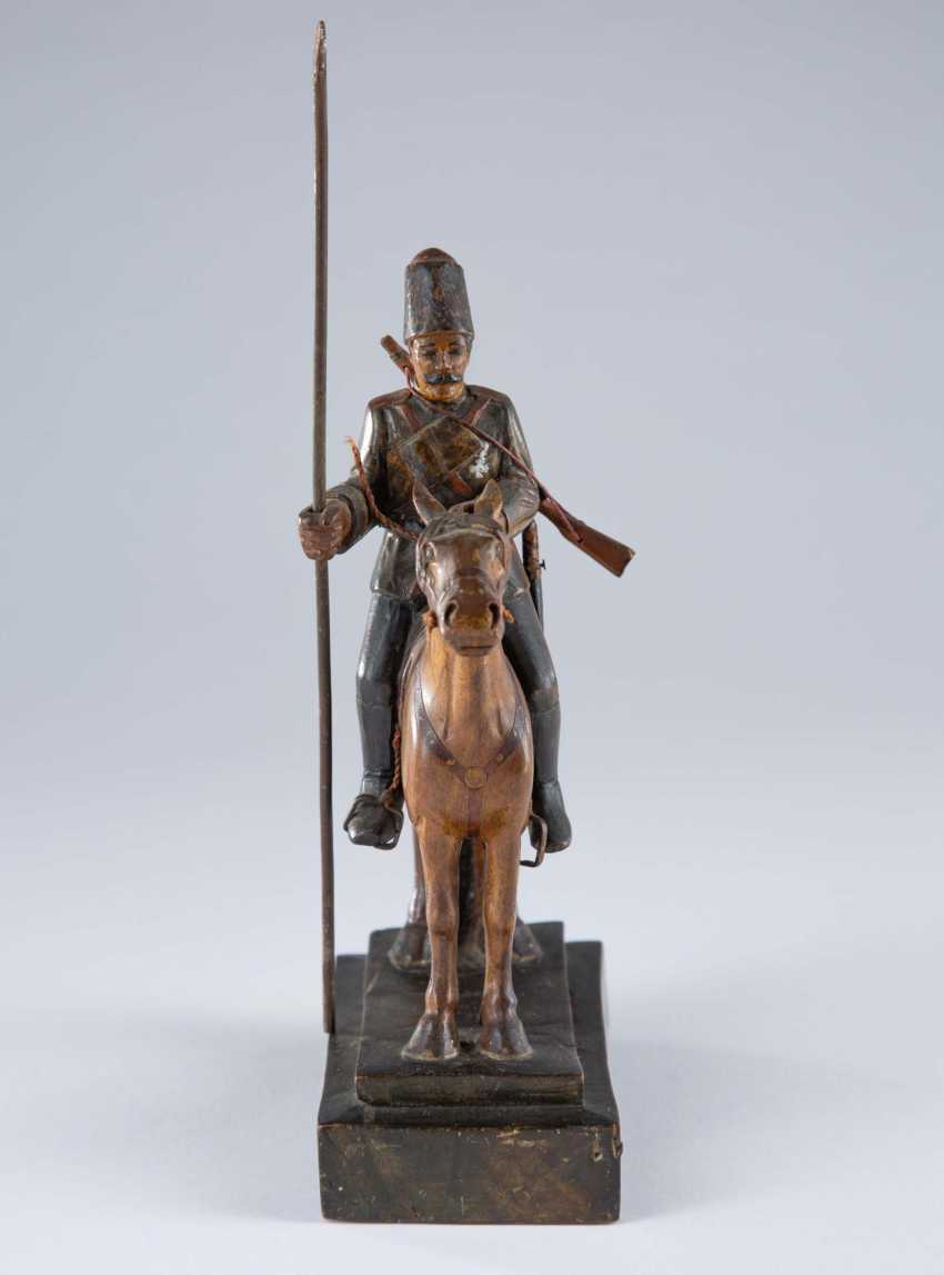 The figure of a Cossack on horseback. - photo 1