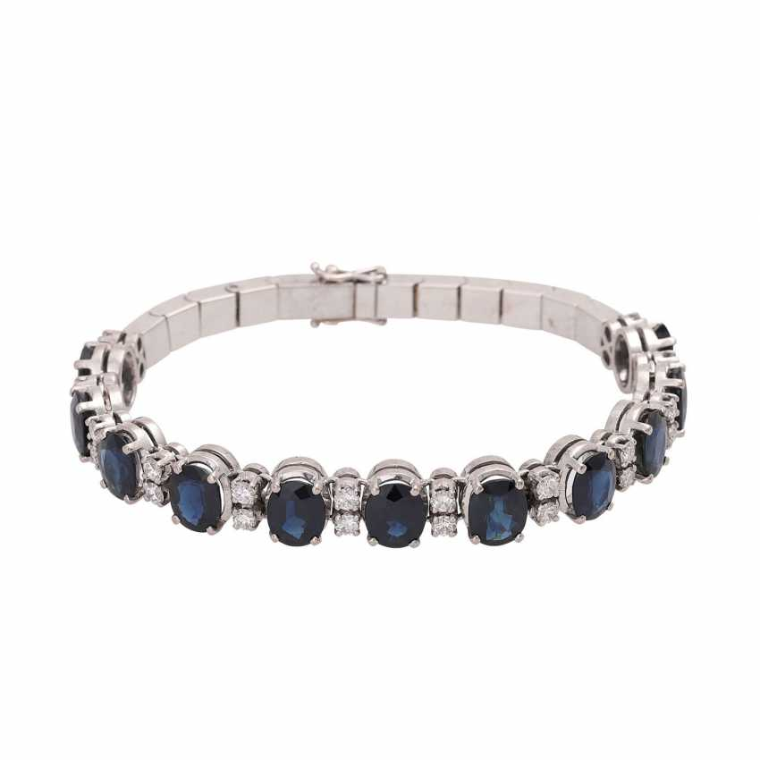 Fine bracelet, bes. with 11 sapphires, together CA. 13,0 cts. & 24 brilliant-cut diamonds, together approx. 1,20 ct. WHITE/VSI-SI. - photo 1