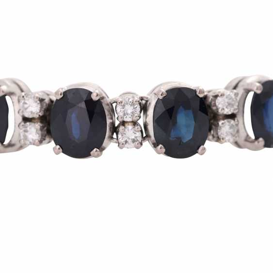 Fine bracelet, bes. with 11 sapphires, together CA. 13,0 cts. & 24 brilliant-cut diamonds, together approx. 1,20 ct. WHITE/VSI-SI. - photo 5