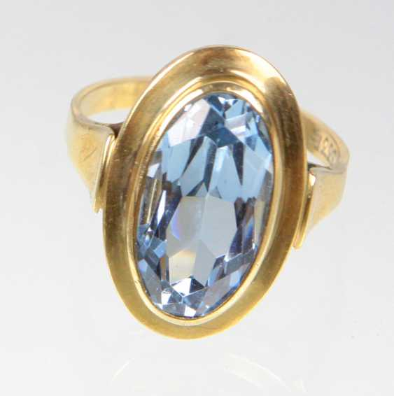 Ring with blue stone yellow gold 333 - photo 1