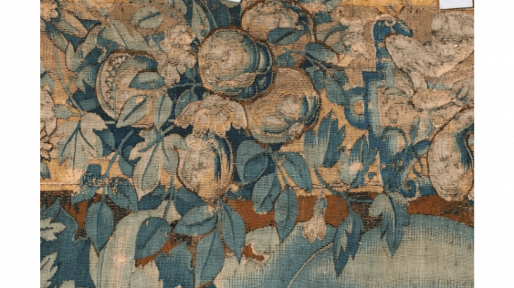 A tapestry with laces , called « feuilles de choux », some restorations and losses