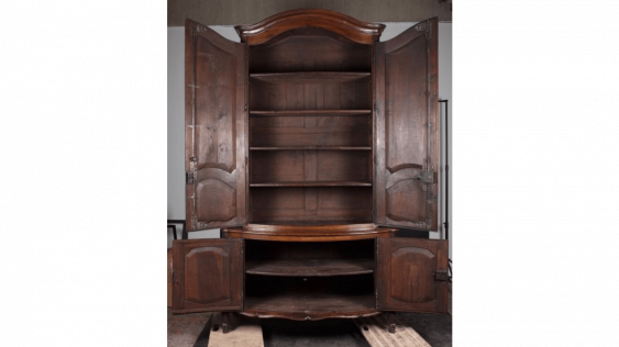 Buffet in walnut molded opening four doors with panelling bypassed