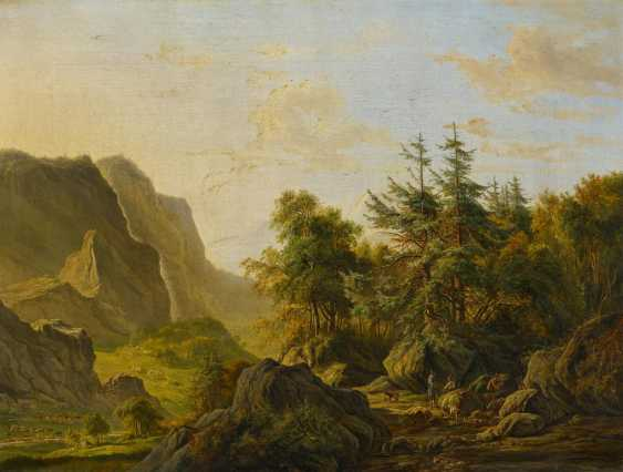 High mountain landscape with hunters in the evening light - photo 1
