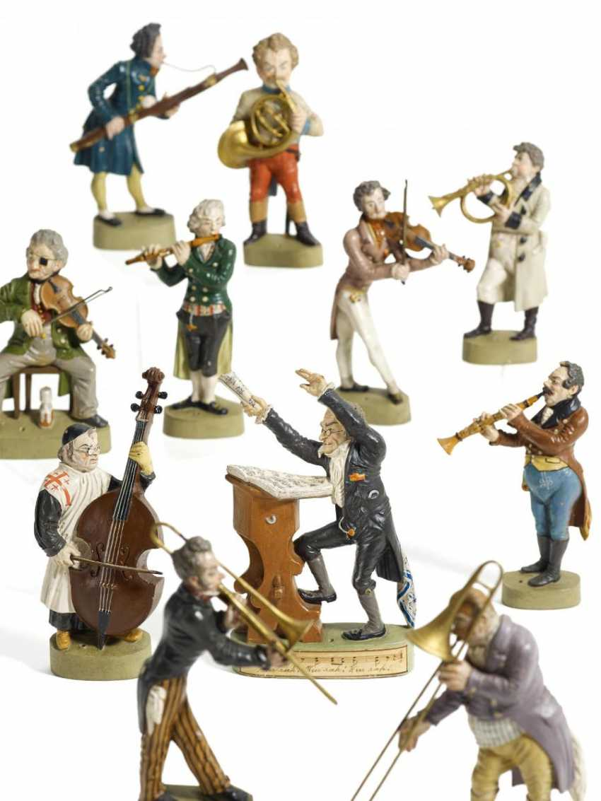 Eleven figures from the large orchestra - photo 1