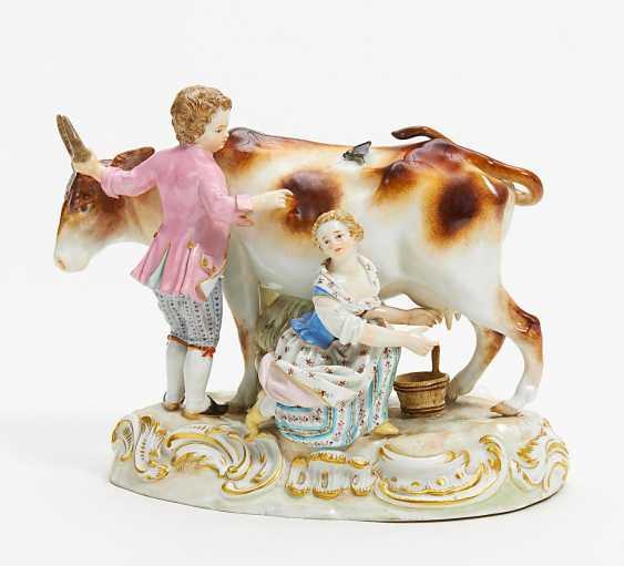 Boy and girl milking - photo 1