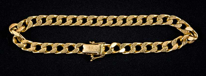 Golden chain bracelet with snap clasp and 2 safety eight - photo 1