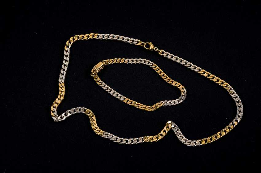 White gold and yellow gold chain with lobster closure and matching chain bracelet with snap clasp and a safety eight - photo 1
