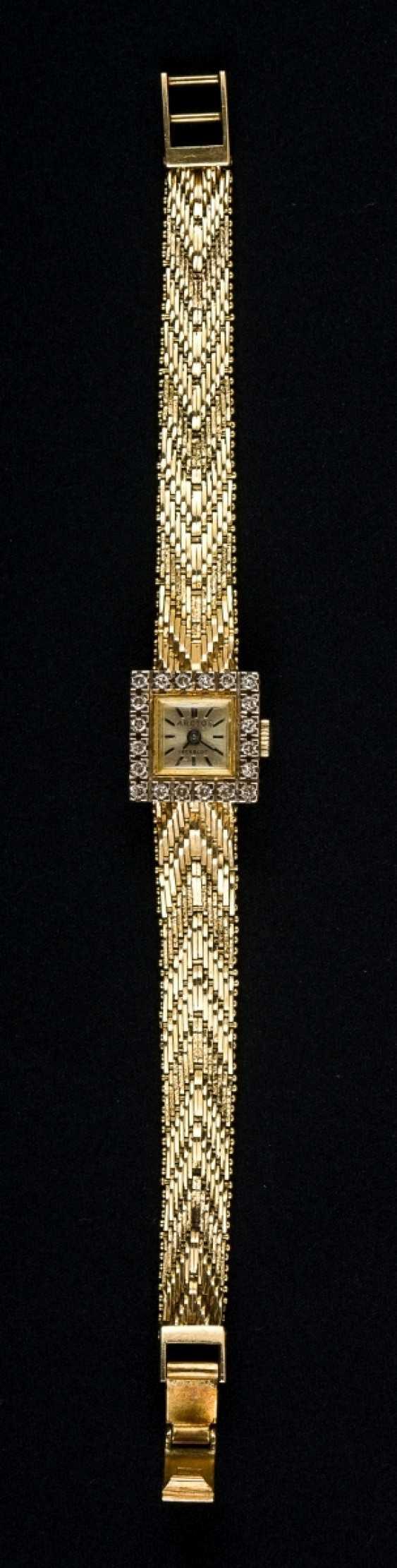 Golden ladies wrist watch with diamonds-trim - photo 1