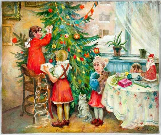 Children decorate the Christmas tree - photo 1