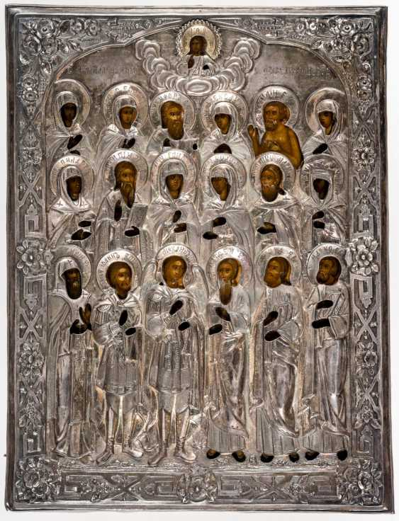 Rare icon with 18 saints and Silberoklad - photo 1