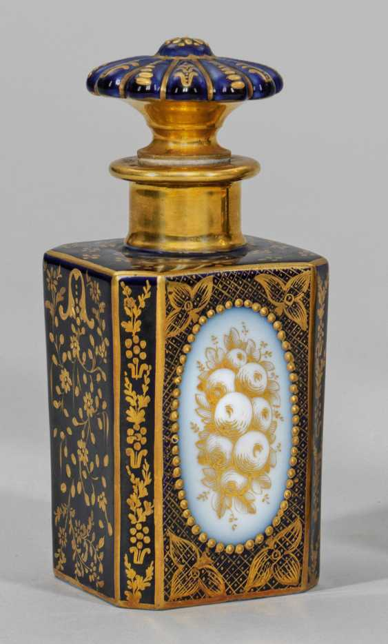 Perfume bottle with gold decoration - photo 1
