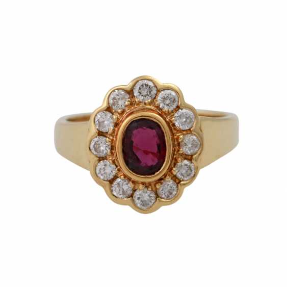 Ring with oval ruby, entouriert of 12 brilliant-cut diamonds, - photo 1
