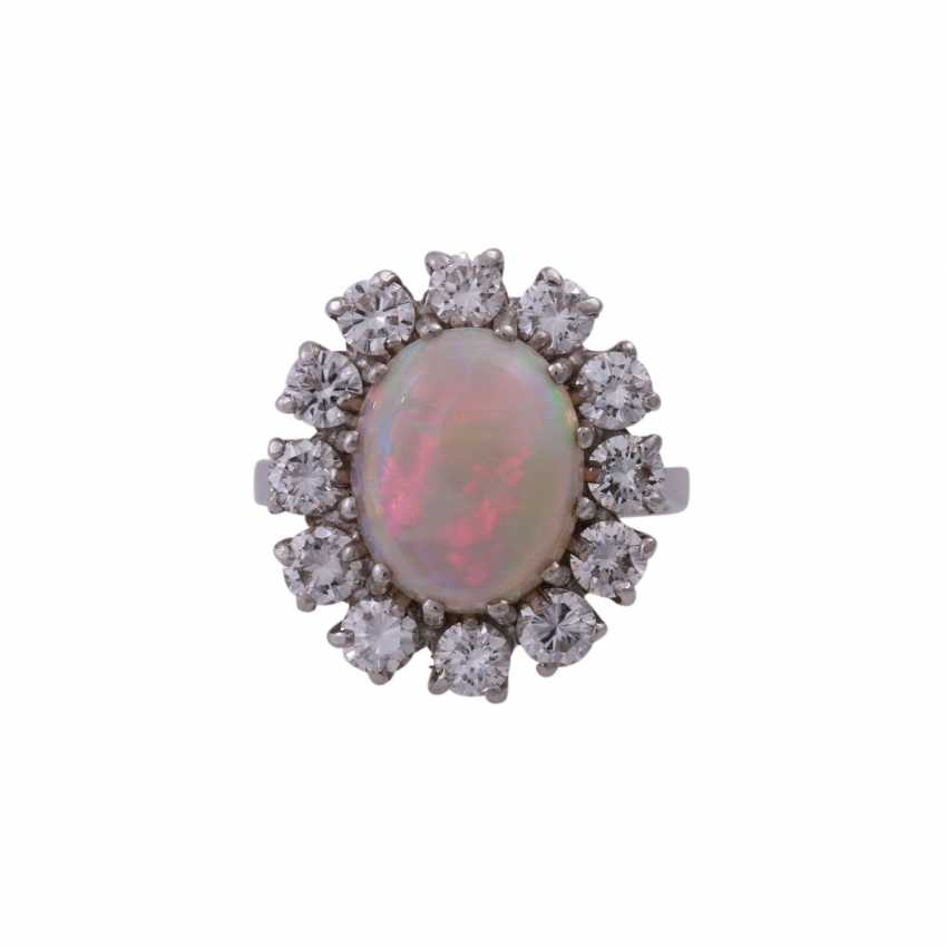 Ring with oval Opal and 12 brilliant-cut diamonds, together CA. 1 ct, - photo 1