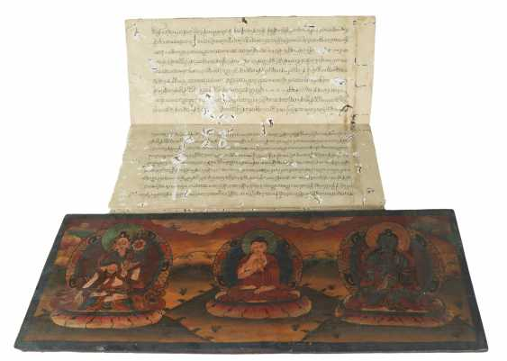 Buddhist manuscript between two elaborately designed and interior with deities painted book covers made of wood and metal applications - photo 1