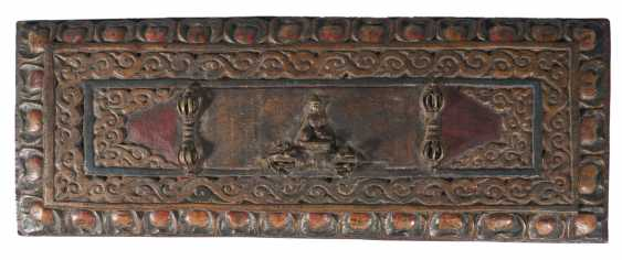 Buddhist manuscript between two elaborately designed and interior with deities painted book covers made of wood and metal applications - photo 2