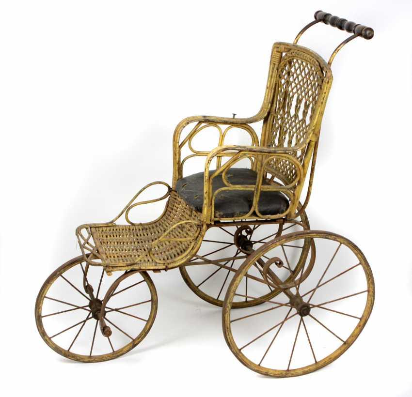 Driving a wheelchair around 1880 - photo 1