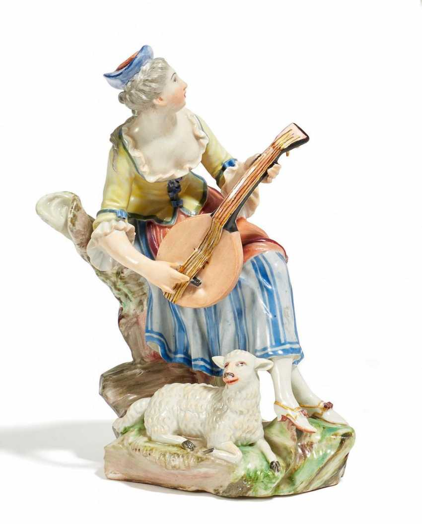 Shepherdess with guitar - photo 1