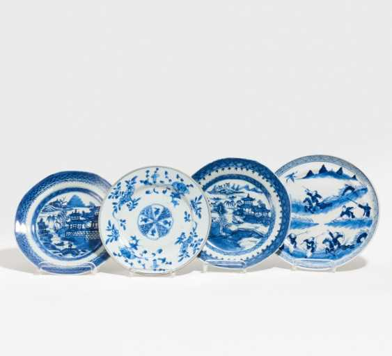 Four blue-and-white plates - photo 1