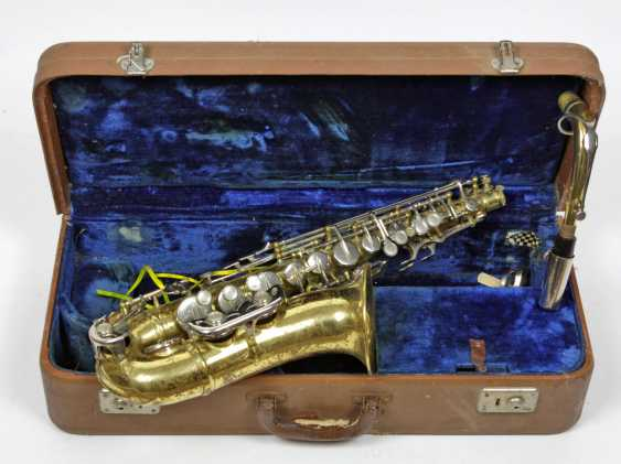 Saxophone in a case  - photo 1