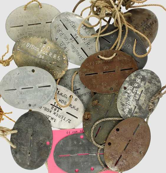 Small collection of 14 dog tags, - photo 1