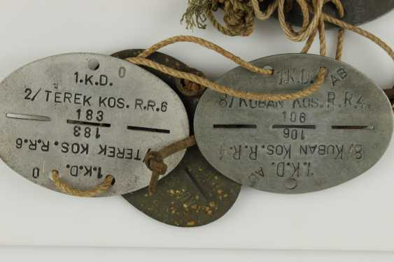 Small collection of 14 dog tags, - photo 2