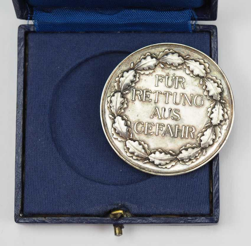 Medal for rescue from danger, in a case. - photo 2
