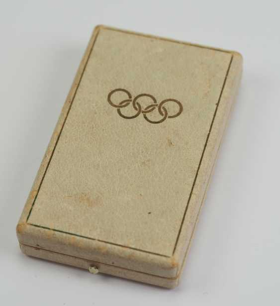 Olympic commemorative medal in a case. - photo 3