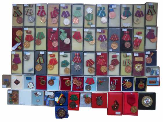 DDR: Lot of awards in a case. - photo 1