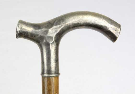 Strolling stick with a silver handle - photo 1