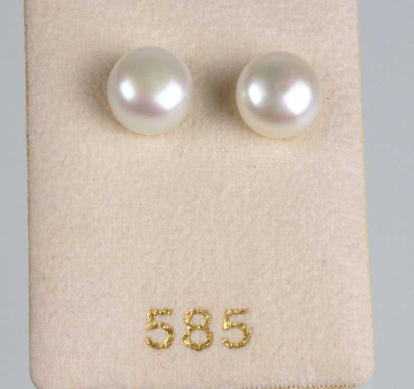 large Golden pearl stud earrings - photo 1
