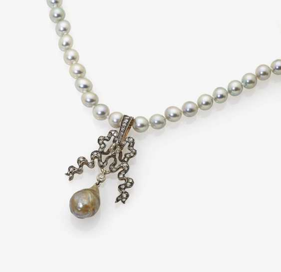 Cultured pearl necklace with bow shaped pendant - photo 1