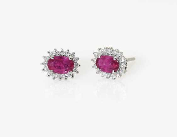 A Pair of stud earrings with rubies and diamonds - photo 1