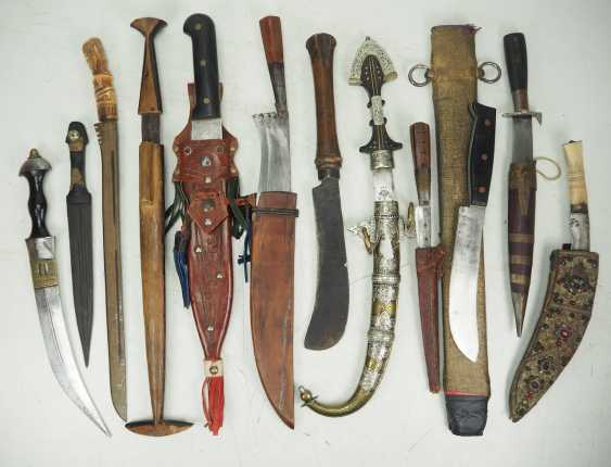 Lot of ethnographic edged weapons. - photo 1