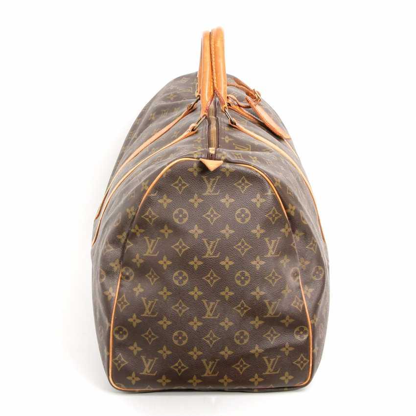 87fe91340c61 Lot 4. LOUIS VUITTON VINTAGE travel bag
