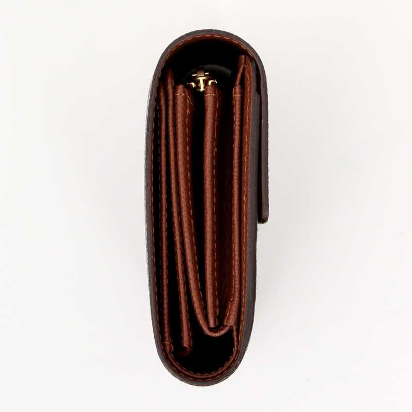 377ddae9e2b2 Lot 36. LOUIS VUITTON timeless wallet