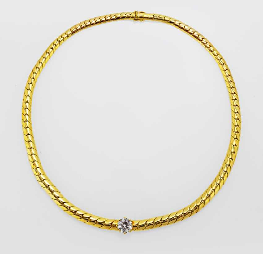 Diamond solitaire in a gold chain taken - photo 1