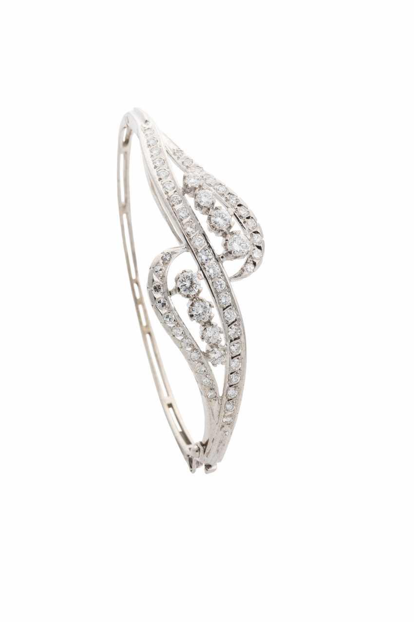 Gold bangle with white diamonds - photo 1
