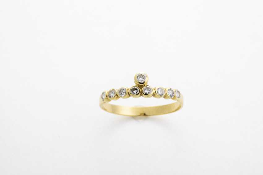 Yellow gold ring with diamonds - photo 1