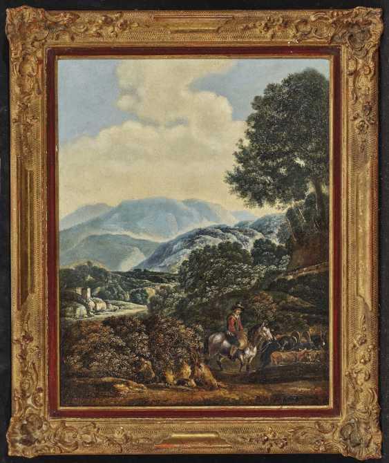 Shepherds in a mountain landscape - photo 2